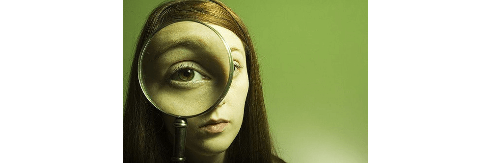 Girl using a magnifying glass