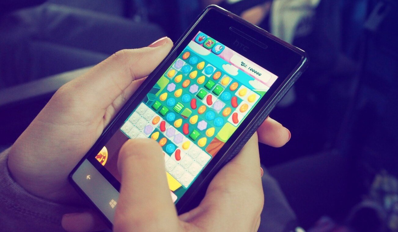 Woman playing a mobile game