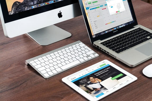 Apple Imac, Ipad and mac book place on a table