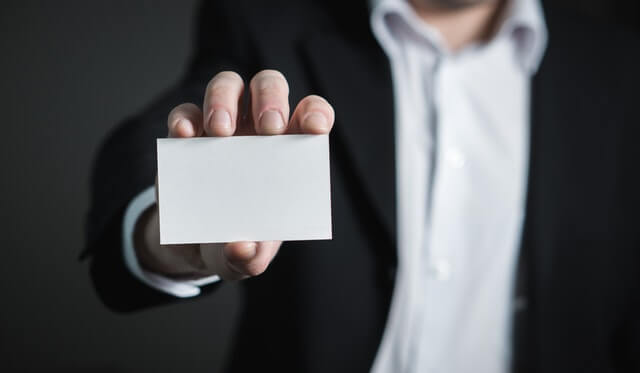 Business man showing a blank calling card