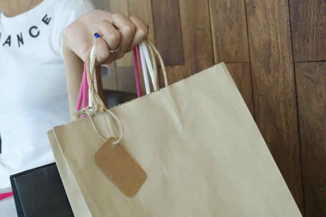 customer holding a paper bag