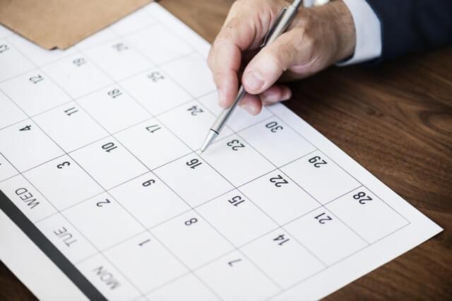 business man checking editorial calendar