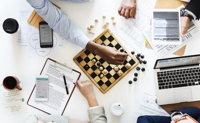 business men playing strategy game